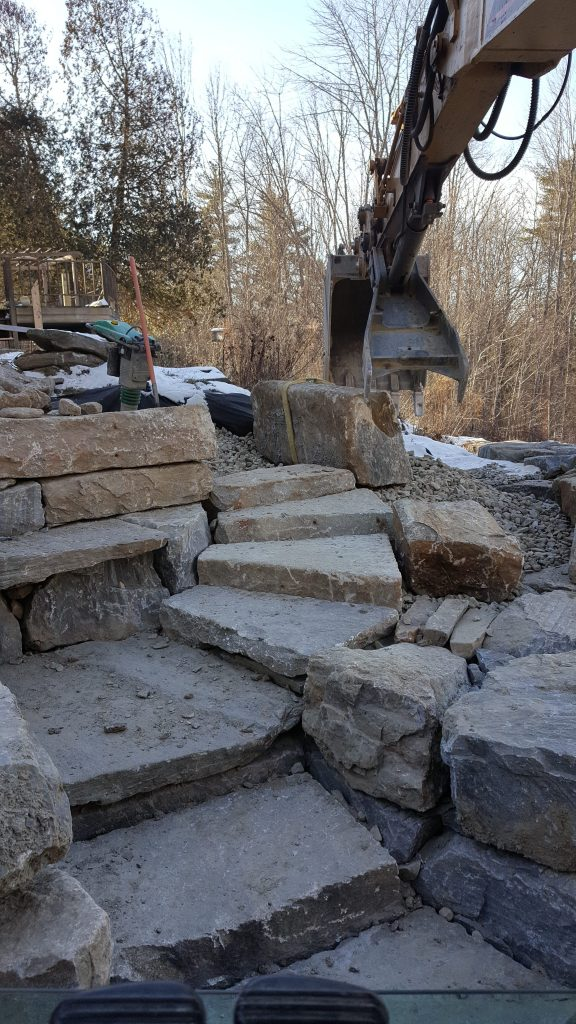 Rock retaining walls with winding stairs